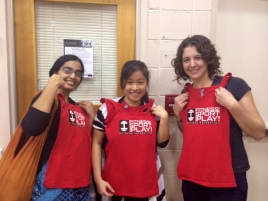 Neha, Khoi, and Caroline with their free shirts after successfully completing a 4-minute plank during Rutgers Judgement Day 2013